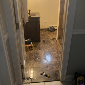 Bathroom Remodel 15 Out with the marble floor, in with a new tile floor