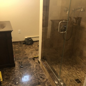 Bathroom Remodel 14 Out with the marble floor, in with a new tile floor