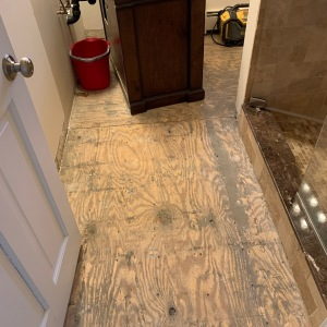 Bathroom Remodel 16 Out with the marble floor, in with a new tile floor